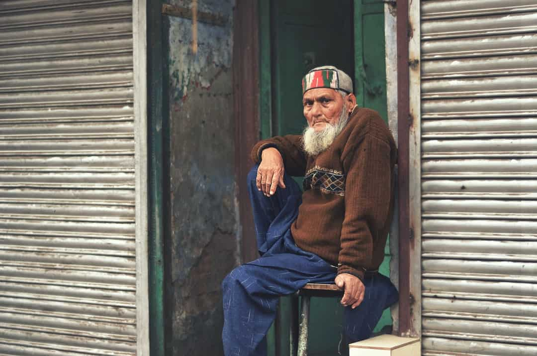 A man sitting in front of a window